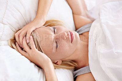 Buy stock photo A beautiful young woman sleeping in her bed