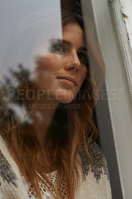 Buy stock photo Closeup shot of a beautiful young woman staring out through a window