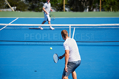 Buy stock photo Rearveiw shot of two people playing tennis outdoors