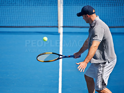 Buy stock photo Shot of a man trying to return a ball on a tennis court