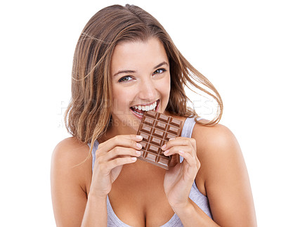 Buy stock photo An attractive young woman eating a slab of chocolate