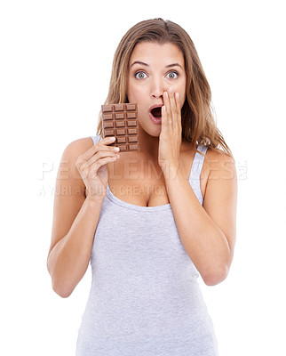 Buy stock photo Portrait of an attractive young woman looking surprised while holding a slab of chocolate