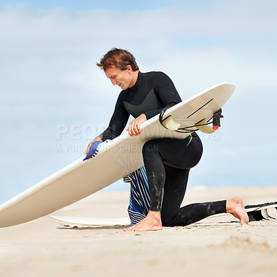 Buy stock photo A young man and his surfboard