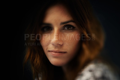 Buy stock photo A gorgeous young woman against a dark background
