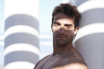 Buy stock photo Portrait of a shirtless young man posing confidently outdoors