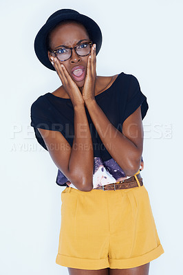 Buy stock photo Portrait of an attractive young African woman looking shocked