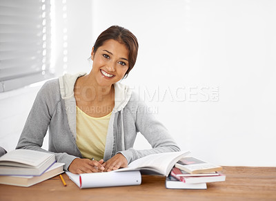 Buy stock photo A pretty young university student studying for her finals in her dorm room