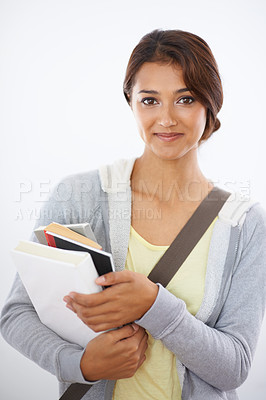 Buy stock photo Cropped shot of a young college student carrying her books and smiling