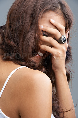 Buy stock photo A woman laughing with her hand over her face