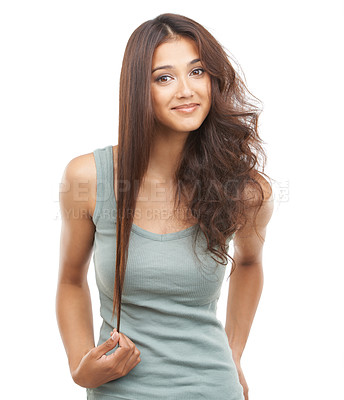 Buy stock photo A young woman with one half of her hair sleek and the other half straight