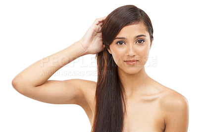 Buy stock photo A beautiful young woman holding her hair and looking at the camera