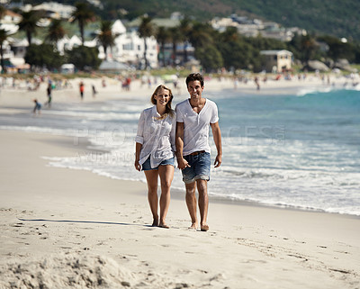 Buy stock photo A happy couple walking on the beach