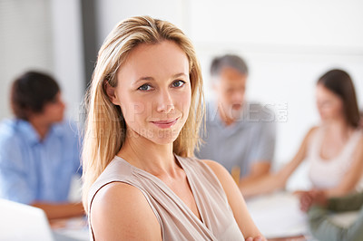 Buy stock photo Portrait of a beautiful woman smiling at you with her colleagues in the background