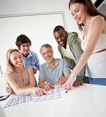 Buy stock photo A group of excited colleagues working on a project together