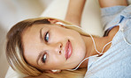 Pretty woman listening music at home