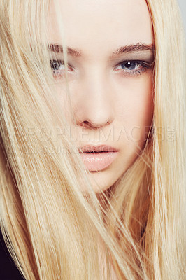 Buy stock photo Closeup portrait of an attractive young blonde woman in studio