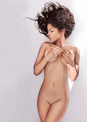 Buy stock photo Studio shot of a nude woman looking away from the camera