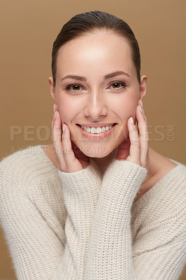 Buy stock photo Cropped portrait of a smiling young woman touching her face