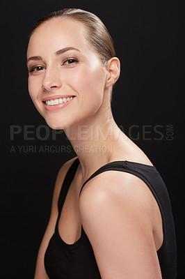 Buy stock photo Studio portrait of an attractive young woman isolated on black