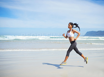Buy stock photo Full length shot of a young woman running along the seashore