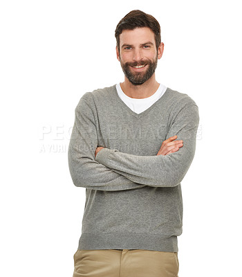 Buy stock photo Studio shot of a young man standing with his arms folded