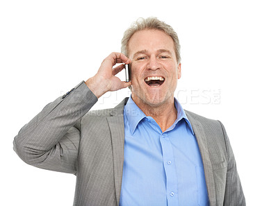 Buy stock photo Studio portrait of a mature businessman talking on a phone