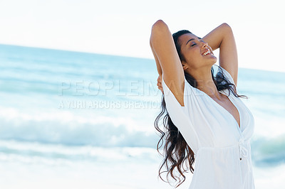 Buy stock photo Beautiful woman on the beach with her arms lifted