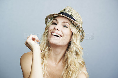 Buy stock photo Portrait of a gorgeous woman wearing a hat posing against a gray background