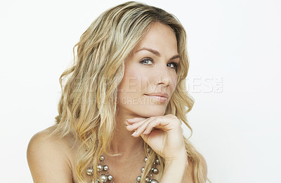 Buy stock photo Cropped portrait of a beautiful young woman against a white background