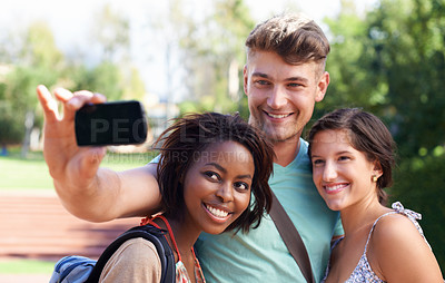 Buy stock photo A group of students taking a self-portrait on a camera phone