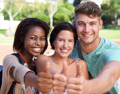 Buy stock photo A group of students smiling at the camera and holding a thumbs up sign