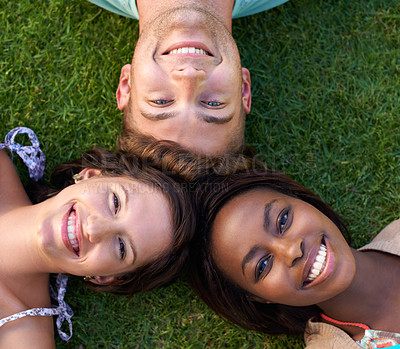 Buy stock photo Close up of a group of smiling teenagers lying down looking at the camera