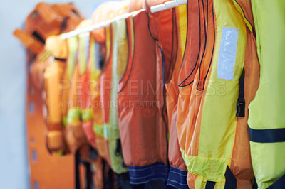 Buy stock photo Shot of life vests on a hanger