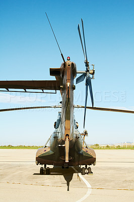 Buy stock photo A military helicopter standing on a launchpad