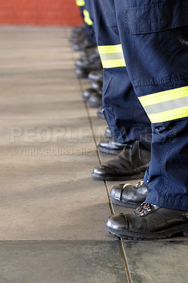 Buy stock photo Shot of a the legs of a line of firemen