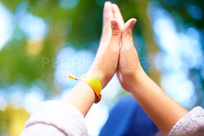 Buy stock photo Cropped shot of two woman giving one another a high five