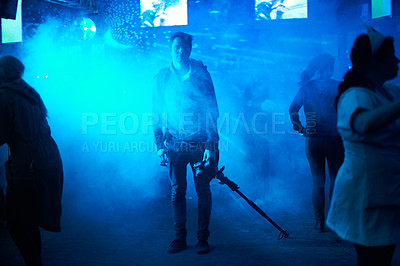 Buy stock photo Portrait of a young man standing isolated from the rest of the crowd