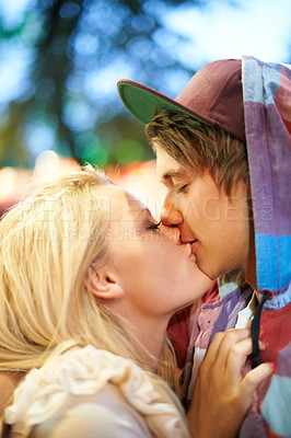 Buy stock photo Cropped view of a young couple kissing