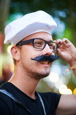 Buy stock photo A young man dressed in a french costume with a fake mustache and beret