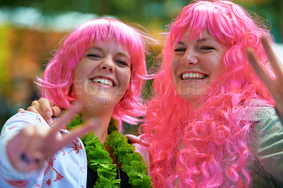 Buy stock photo Portrait of two young women dressed up in wigs at an outdoor festival