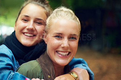 Buy stock photo Portrait of two young women having a good time at an outdoor festival