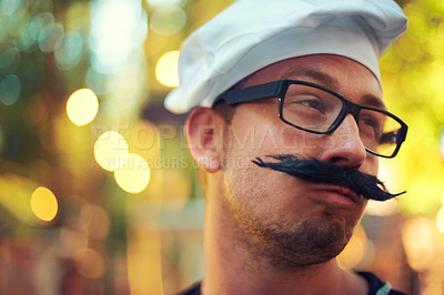 Buy stock photo A young man dressed up in a fake mustache with glasses and a beret