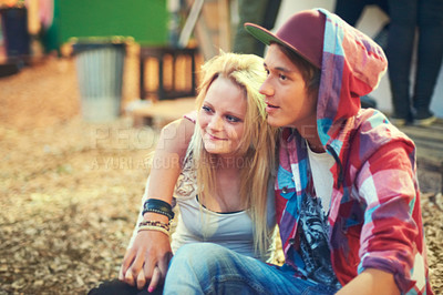 Buy stock photo Shot of an affectionate young couple having a good time at an outdoor festival