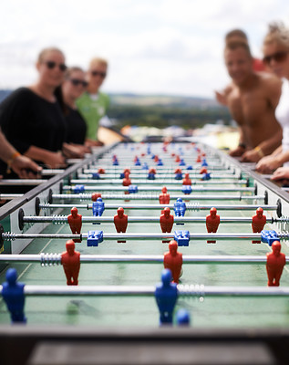 Buy stock photo Cropped shot of people playing foosball outdoors