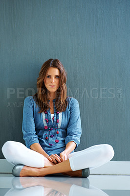 Buy stock photo Relaxed young lady sitting on the floor