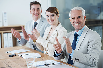 Buy stock photo Shot of a business group clapping