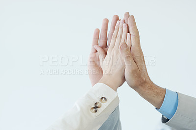 Buy stock photo Business people celebrating another success deal with a high-five