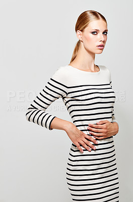 Buy stock photo Studio portrait of a stylish young blonde woman against a gray background