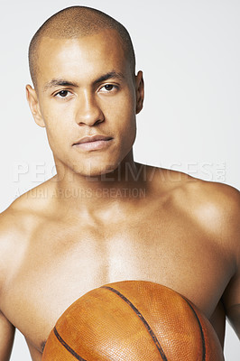Buy stock photo Portrait of a young man holding a basket ball