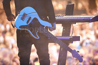 Buy stock photo A performer standing with his guitar in front of a keyboard facing the audience